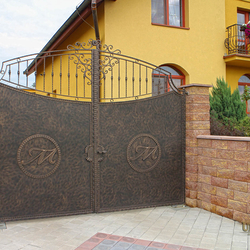 A wrought iron gate with a logo