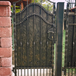 A full wrought iron gate with metal for the cottage
