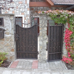 A wrought iron fence - metal plate and wrought iron combination