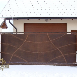 A solid wrought iron gate