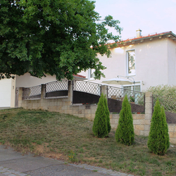 A wrought iron fencing - a family house